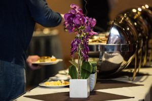 Sunday brunch buffet at Timberlake Restaurant decorated with purple flowers